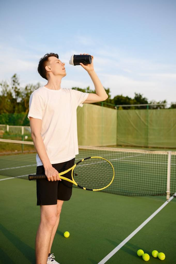 tennis player drinking filtered water